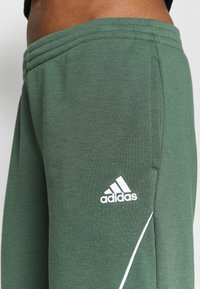 adidas Performance - Tracksuit bottoms - green/white - 4