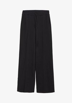 HANNAA - Trousers - black