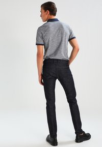 Diesel - THOMMER-X - Slim fit jeans - blue-black - 2