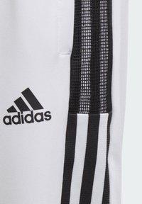 adidas Performance - TRIO - Tracksuit bottoms - white - 5