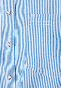 ONLY - ONLLECEY STRIPE KNOT - Button-down blouse - cloud dancer/medium blue