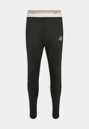 DELUXE AGILITY JOGGER - Tracksuit bottoms - black