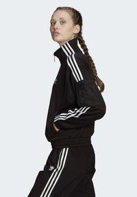 adidas Originals - TRACK TOP - Trainingsjacke - black - 3