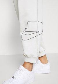 Nike Sportswear - Tracksuit bottoms - light bone - 5
