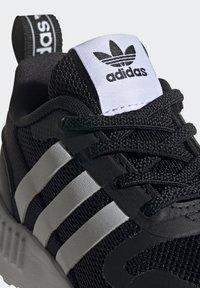 adidas Originals - MULTIX UNISEX - Baby shoes - core black/ftwr white/core black - 6