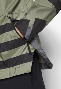 adidas Performance - URBAN ALLOVER PRINT WIND.RDY  - Outdoor jacket - green - 4