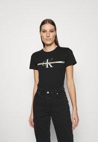 Calvin Klein Jeans - MONOGRAM TEE - Print T-shirt - black - 0