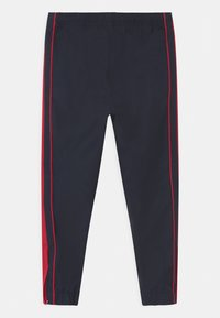Lacoste Sport - TENNIS UNISEX - Tracksuit bottoms - navy blue/ruby - 1
