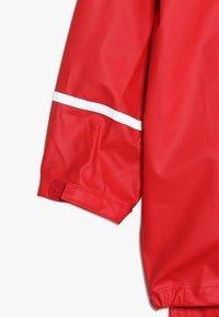 CeLaVi - BASIC RAINWEAR SUIT SOLID - Pantalones impermeables - red - 8