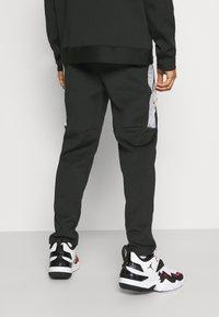 Jordan - AIR PANT - Tracksuit bottoms - black/white - 2