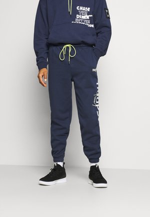 FRANCHISE - Pantalon de survêtement - peacoat