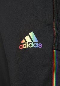 adidas Performance - TIRO PRIDE - Pantaloni sportivi - black - 4