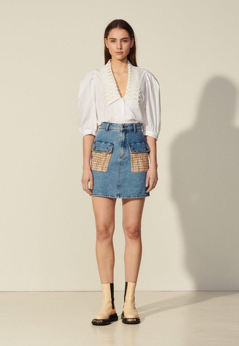 sandro - FIORINA - Mini skirt - bleu denim