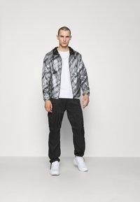 Emporio Armani - BLOUSON JACKET - Waterproof jacket - grey - 1