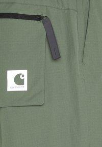 Carhartt WIP - HURST PANT - Tracksuit bottoms - dollar green - 7