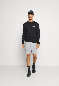 Jack & Jones Performance - JCOZ SPORT CREW NECK - Sweatshirt - black - 1