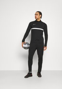 Nike Performance - ACADEMY 21 PANT - Tracksuit bottoms - black - 1