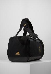 adidas Performance - REAL MADRID - Bolsa de deporte - black/dark gold - 3