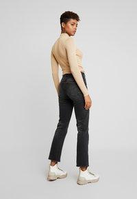 G-Star - CODAM HIGH KICK FLARE 7\8 WMN - Flared Jeans - worn in basalt - 2