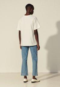 sandro - Print T-shirt - blanc - 2