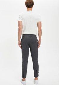 DeFacto Fit - Tracksuit bottoms - grey - 2