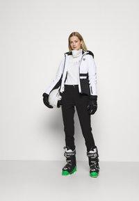 Luhta - JOENTAKA - Ski- & snowboardbukser - black - 1