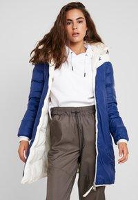 Nike Sportswear - Down coat - pale ivory/blue void - 3