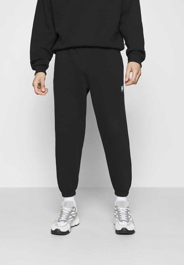 TRACKPANTS - Pantalon de survêtement - black