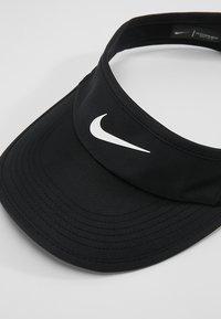 Nike Performance - WOMEN AEROBILL FEATHERLIGHT VISOR ADJUSTABLE - Cap - black/white - 4