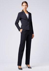 BOSS - TAMEA - Trousers - dark blue - 1