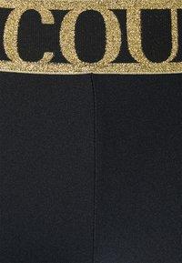 Versace Jeans Couture - LADY FUSEAUX - Leggings - Trousers - black - 2