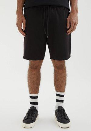 MIT STRETCHBUND - Shortsit - mottled black