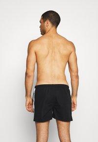 Ellesse - FADALDTO - Shorts da mare - black - 1