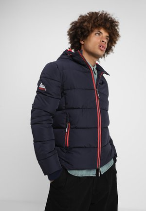 SPORTS PUFFER - Winter jacket - navy/bright red