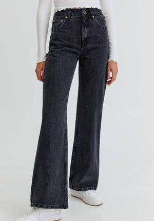 MIT SCHLAG UND HOHEM BUND - Flared Jeans - mottled black
