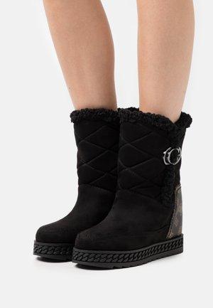 HADERA - Platform ankle boots - black/brown