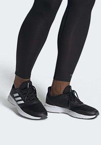 adidas Performance - NOVA FLOW SHOES - Zapatillas de running neutras - black - 0