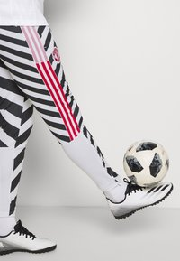 adidas Performance - MANCHESTER UNITED  - Tracksuit bottoms - white/black - 4