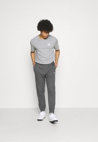 Nike Sportswear - CLUB PANT - Tracksuit bottoms - charcoal heathr/anthracite/white - 1