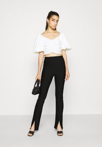 Gina Tricot - FRONT SLIT TROUSERS - Trousers - black - 1