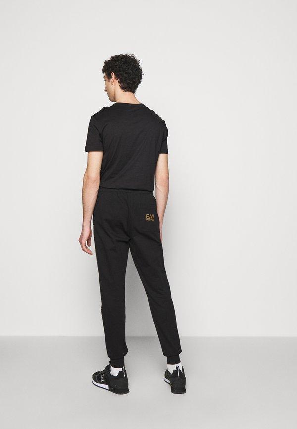 EA7 Emporio Armani Spodnie treningowe - black/gold/czarny Odzież Męska MFVS