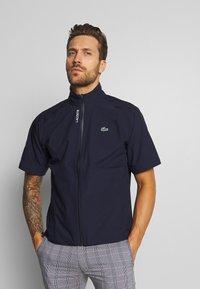 Lacoste Sport - HIGH PERFORMANCE JACKET - Waterproof jacket - navy blue/white - 2