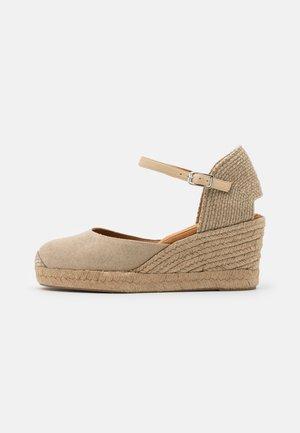 CACERES - Sandały na platformie - natural