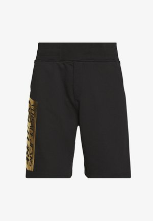 LOGO - Tracksuit bottoms - black/gold