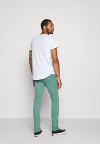 Hollister Co. - FLORAL PRINT LOGO - Print T-shirt - white solid - 2