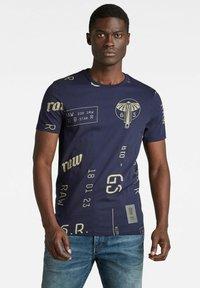 G-Star - GRAPHICS ALLOVER SLIM - Print T-shirt - warm sartho extreme - 0