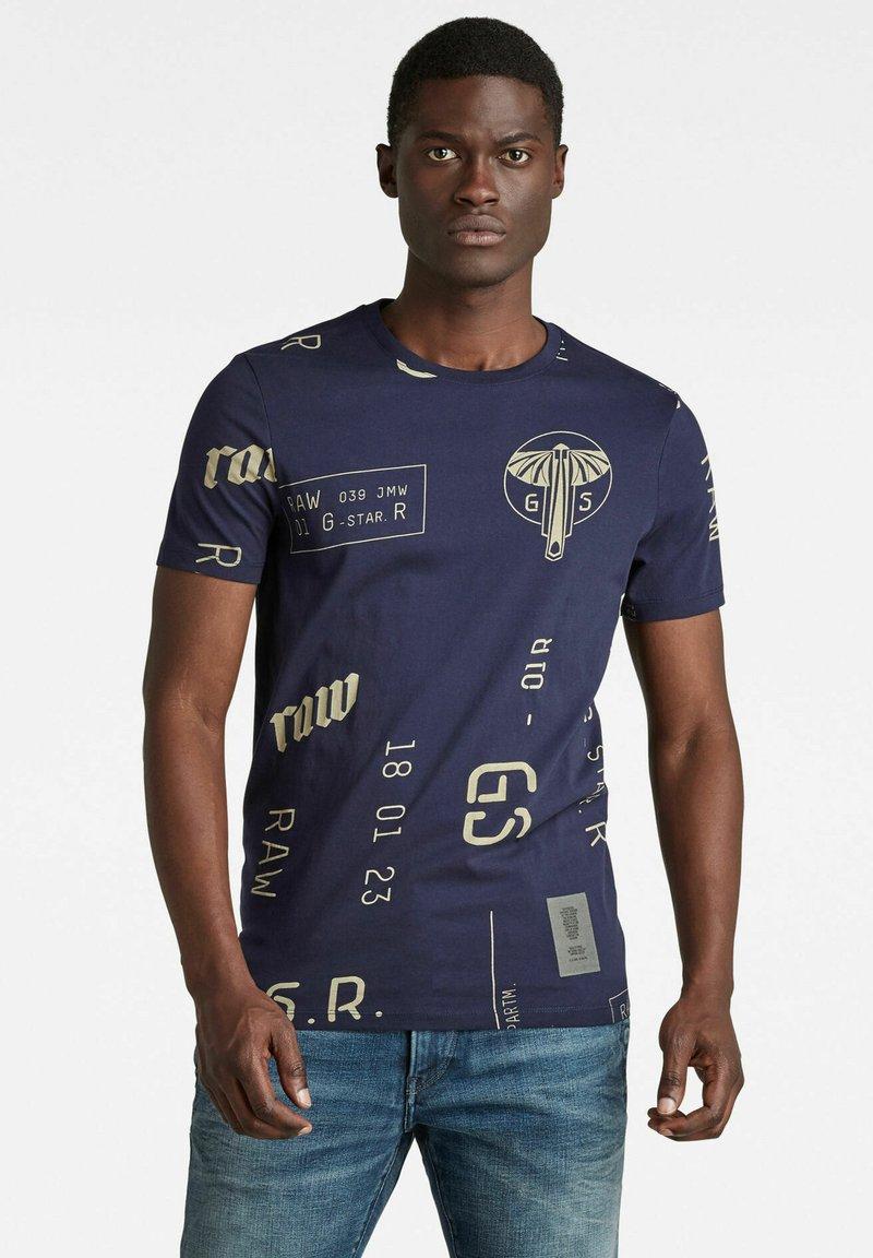 G-Star - GRAPHICS ALLOVER SLIM - Print T-shirt - warm sartho extreme