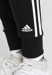 adidas Performance - PANT - Tracksuit bottoms - black/white - 3