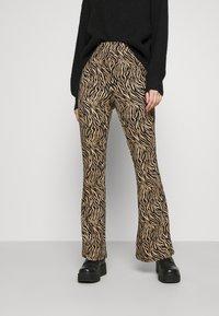 Vila - VIWINNER FLARED PANT - Leggings - brown/black - 0