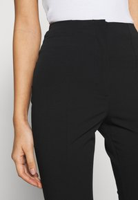 Monki - VIOLET TROUSERS - Trousers - black dark - 4